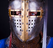 Blue eyes of knight. Noble knight wearing  a helmet Stock Image