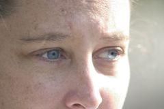 Blue eyes looking Stock Image