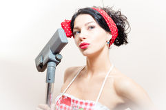 Blue eyes pinup woman with vacuum cleaner. Beautiful funny young black haired blue eyes pinup woman with vacuum cleaner Stock Photos
