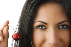 Blue eyes red cherry Royalty Free Stock Images