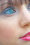 Blue eyes and red lips. A macro image of a blue penetrating eye and red lips: the ultimate female beauty Royalty Free Stock Photo