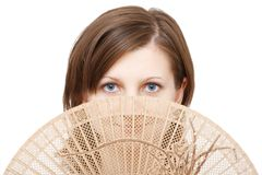 Blue eyes woman with fan. On white background stock image