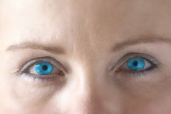 Blue eyes of the women Stock Photo
