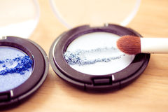 Blue eyeshadow and brush, cosmetics series Stock Photos