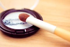 Blue eyeshadow and brush, cosmetics series Stock Photography