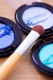 Blue eyeshadow and brush, cosmetics series Royalty Free Stock Image