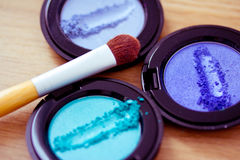 Blue eyeshadow and brush, cosmetics series Stock Images
