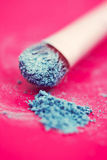 Blue eyeshadow and brush macro Stock Images