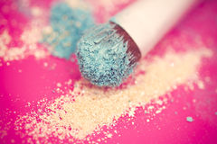 Blue eyeshadow and brush macro Royalty Free Stock Photo