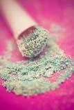 Blue eyeshadow and brush macro Royalty Free Stock Image