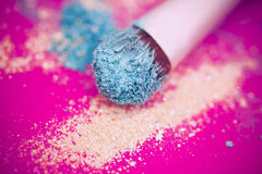 Blue eyeshadow and brush macro Stock Photography