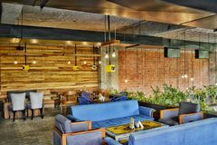 Blue Fabric 4-piece Sofa Set Under Lighted Hanging Bulbs Stock Photos