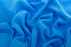 Blue fabric as a background.. Crumpled blue fabric texture closeup Royalty Free Stock Image