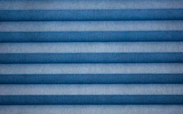 Blue Fabric Background. A background with a view of a blue textured fabric with striped design Royalty Free Stock Photo