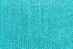 Blue fabric background. Blue fabric textured background, close up Stock Images