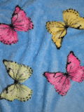 Blue fabric with butterfly Royalty Free Stock Image