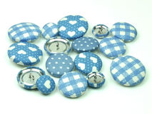 Blue fabric buttons isolated Stock Photography