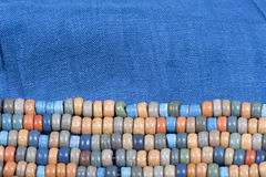 Blue fabric with colored beads Stock Photo