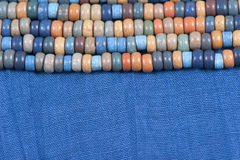 Blue fabric with colored beads Royalty Free Stock Photography