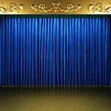 Blue fabric curtain with gold on stage Royalty Free Stock Photos