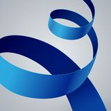 Blue fabric curved ribbon on grey background Royalty Free Stock Photography