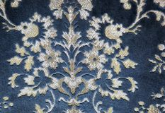 Blue fabric with flowers Royalty Free Stock Image