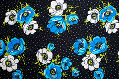 Blue fabric with flowers Stock Images