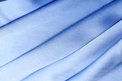 Blue fabric folds Royalty Free Stock Image