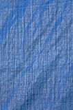 Blue fabric with lines as a background or texture Royalty Free Stock Images