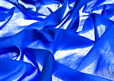 Blue fabric on lit background Stock Photo