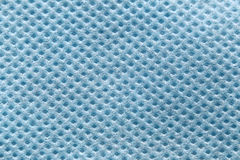 Blue fabric in macro style. Royalty Free Stock Photos