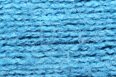 Blue fabric in a macro style. Royalty Free Stock Photo