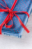 Blue fabric pile with red ribbon. Kit of blue fabric pile with red ribbon Stock Images
