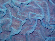 Blue fabric on a red background Stock Photography
