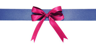 Blue fabric ribbon and violet bow on white background. Blue fabric ribbon and violet bow. Isolated on white background Stock Photo