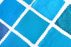 Blue fabric samples. On light background Royalty Free Stock Image