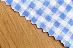 Blue fabric of scots pattern on wooden. Royalty Free Stock Photo