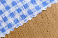 Blue fabric of scots pattern on wooden. Stock Images