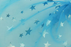 Blue fabric with stars Royalty Free Stock Photos