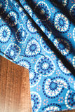 Blue fabric textile with ornament on wooden Royalty Free Stock Photo