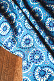 Blue fabric textile with ornament on wooden Stock Photos