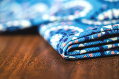 Blue fabric textile with ornament on wooden Stock Images