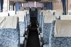 Blue fabric vehicle seat on bus. Blue fabric vehicle seat in interior mini bus Royalty Free Stock Photo
