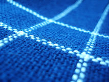 Blue fabric with white lines Stock Image