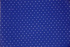 Blue fabric with white polka dots. royalty free stock photo