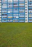 Blue facade and green grass Stock Photography