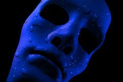 Blue face mask with water drops texture royalty free stock photography