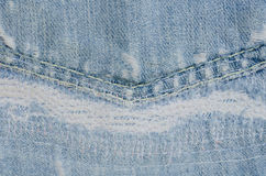 Blue faded ripped jeans Royalty Free Stock Images