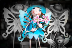 Blue fairy with flowers. Blue smiling fairy with pink flowers & other fairies in black stock images