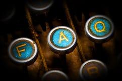 Blue faq typewriter keys. Close up on old blue faq typewriter keys royalty free stock photos